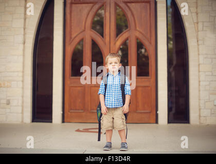Portrait of a little boy on his first day of school - Stock Photo