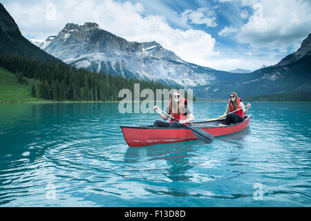 Two girls kayaking, Yoho National Park, British Columbia, Canada - Stock Photo