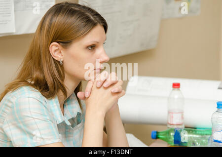 A girl student of European-style protects the thesis project - Stock Photo