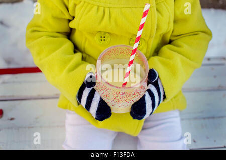 Close-up of a girl holding a drink - Stock Photo
