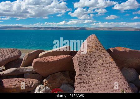 Mani stone with Mantra, at Namtso Lake, Holy Mountain, Qinghai-Tibet Plateau, Tibet, China, Asia - Stock Photo