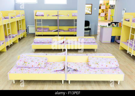 modern bedroom with small bunk beds with stairs for the kids stock photo
