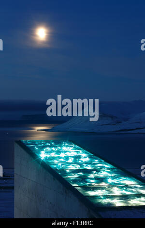 Moon and glittering facade designed by artist Dyveke Sanne, on the roof of the Svalbard Global Seed Vault. Light - Stock Photo
