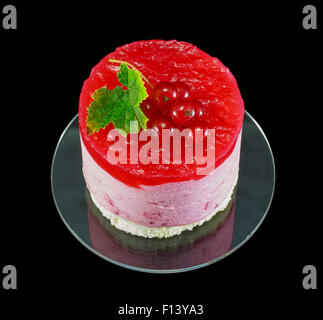 One small redcurrant cake decorated with berries - Stock Photo