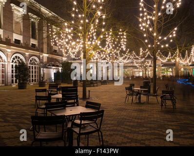 illuminated terrace around christmas time in amsterdam, netherlands - Stock Photo