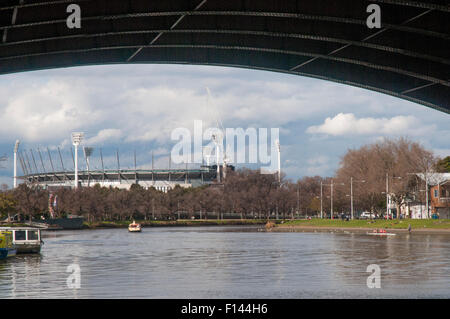 Melbourne Cricket Ground (MCG) beyond the Yarra River at Princes Bridge, Melbourne - Stock Photo