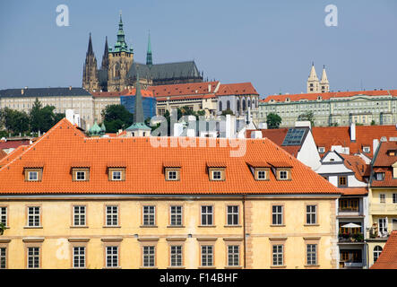 View over rooftops in Prague - Prague Castle is in the background - Stock Photo