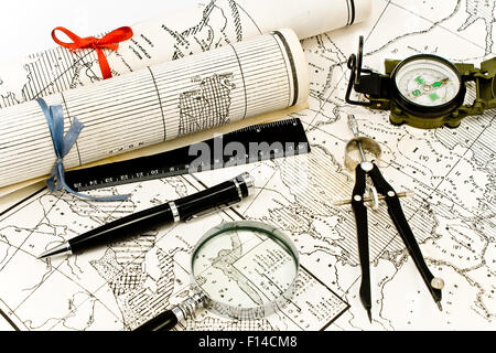 Old Maps in rolls with tools for navigation - Stock Photo