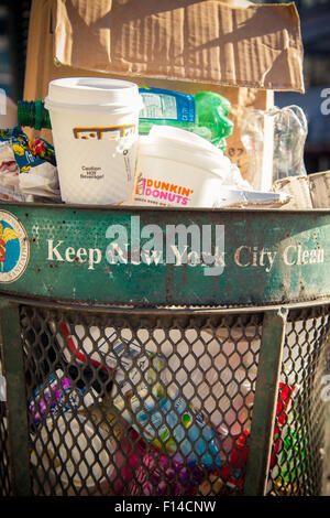 Full trash can in New York City - Stock Photo
