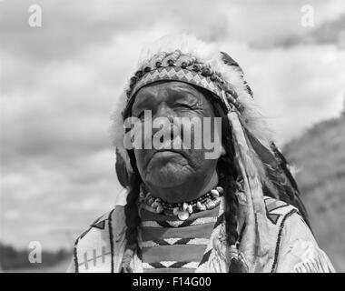 1960s PORTRAIT NATIVE AMERICAN MAN CHIEF BLACKFOOT INDIAN TRIBE IN BROWNING MONTANA - Stock Photo