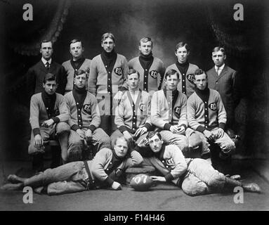 1900s 1907 GROUP PORTRAIT HIGH SCHOOL FOOTBALL TEAM PLAYERS WEARING TEAM UNIFORMS VARSITY SWEATERS - Stock Photo