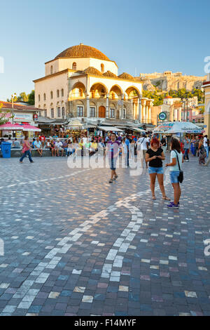 People at the mosque and metro station in Monastiraki square in Athens - Stock Photo
