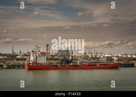 An oil tanker docked at Fawley Oil Refinery near Southampton, Hampshire, UK - Stock Photo