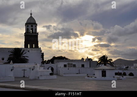 Sunset at Plaza de la Constitución of Teguise with bell tower of Nuestra Señora de Guadalupe Church (Teguise, Lanzarote, - Stock Photo