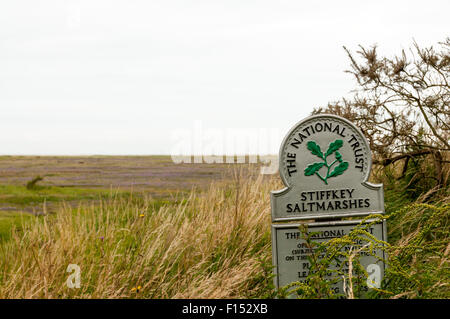 A National Trust sign for Stiffkey Saltmarshes on the North Norfolk coast. - Stock Photo