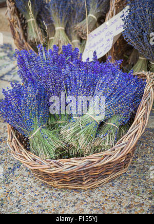 Lavender in front of a store in Sault in Provence - Stock Photo