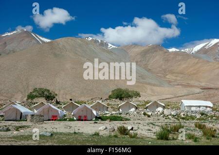 Tended camp at the shore of Pangong Lake or Pangong Tso, Ladakh, Jammu and Kashmir, India - Stock Photo