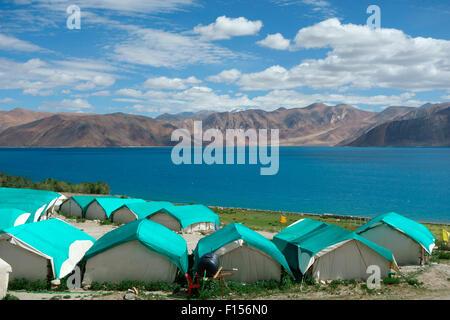 Camping for tourists at the Pangong Lake or Pangong Tso, Ladakh, Jammu and Kashmir, India - Stock Photo