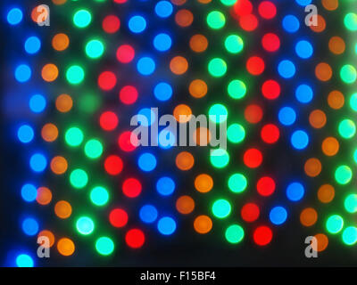 Top view on the blurred bright circles colored abstract image derived from a photo of defocused light bulbs - Stock Photo
