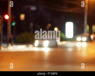 Defocused car, the lights from the headlights and tail lights of cars on the road was blurred for use as a background - Stock Photo