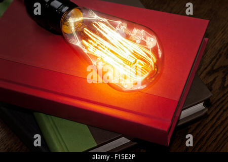 Horrifying vintage Halloween themed skeleton trapped inside lightbulb - Stock Photo