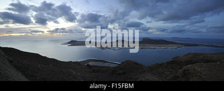 Panoramic landscape view of Chinijo Archipelago from the Mirador del Río at sunset with Salinas del Río (La Graciosa, - Stock Photo