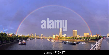 London, UK. 27th August 2015. Rainbow over the River Thames and City of London, England. A shower of rain just before - Stock Photo