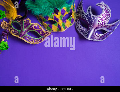 Mardi Gras or carnival mask on bright purple background - Stock Photo