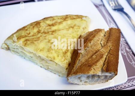 Madrid Spain Europe Spanish Retiro VAIT restaurant inside interior bakery gourmet shop dining food plate omelette - Stock Photo