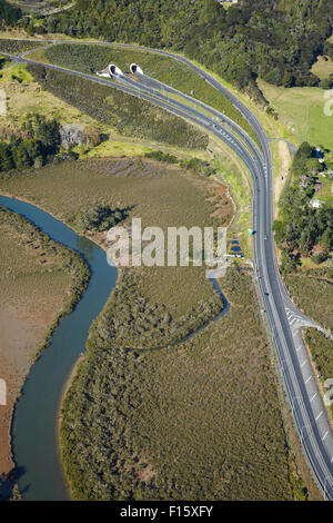 State Highway One at Johnstone's Hill Tunnels, and Puhoi River, North Auckland, North Island, New Zealand - aerial - Stock Photo