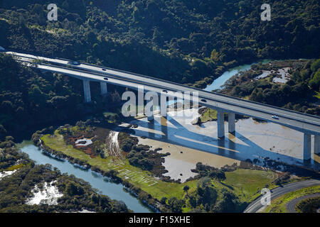 State Highway One at Waiwera Viaduct, North Auckland, North Island, New Zealand - aerial - Stock Photo