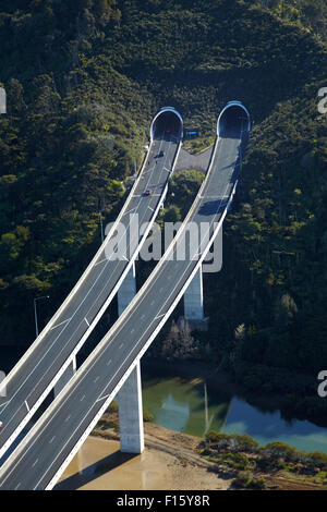 State Highway One at Waiwera Viaduct and Johnstone's Hill Tunnels, North Auckland, North Island, New Zealand - aerial - Stock Photo