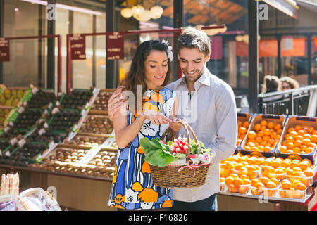 Couple shopping in Paris - Stock Photo
