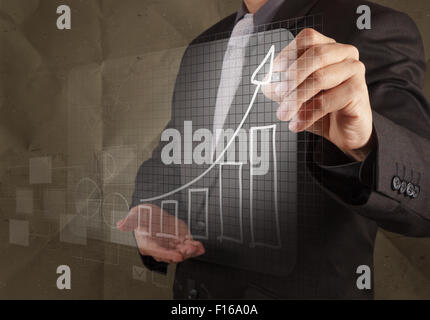 businessman hand draws business strategy with crumpled recycle paper background as concept - Stock Photo
