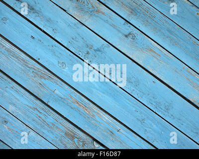 Old wooden boards, located on a diagonal with a shabby blue paint all over the field image for use as a background - Stock Photo