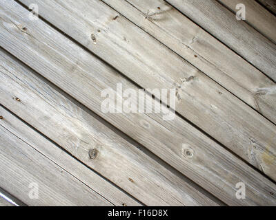 Old wooden boards, located on a diagonal, darkened with age for use as a background or wallpaper - Stock Photo