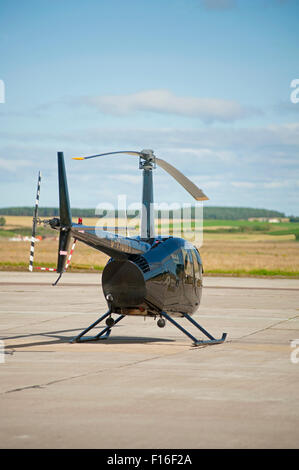 Robinson R44 Raven helicopter (G-MDDT) parked at Inverness airfield Highland Scotland. SCO 10,065. - Stock Photo
