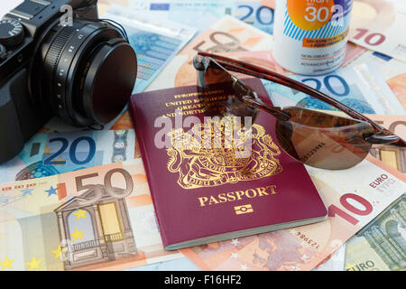 Things for foreign travel with passport currency camera suncream and sunglasses for travelling to Eurozone countries - Stock Photo