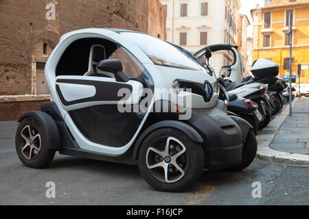 Rome, Italy - August 8, 2015: Renault Z.E. all-electric car stands parked on the roadside in Roma - Stock Photo