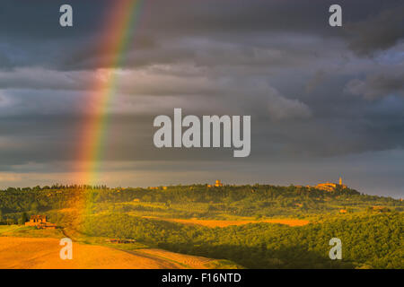 Rainbow with famous Cypress trees in the heart of the Tuscany, near Pienza, Italy - Stock Photo