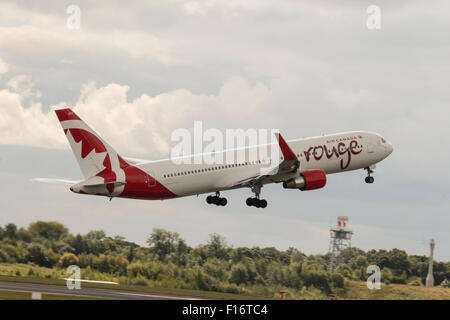 Air Canada Rouge Boeing 767-33A(ER) taking off at Manchester Airport (UK). - Stock Photo
