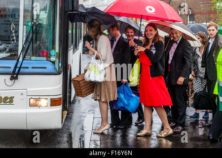 Young Opera Fans Queue To Board A Bus From Lewes To Glyndebourne Opera House To Watch The Opera 'Saul', Lewes, Sussex, - Stock Photo