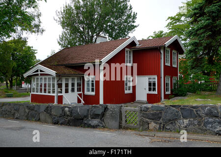 Red cottage in Swedish countryside. Öckerö, Bohuslan. Sweden - Stock Photo