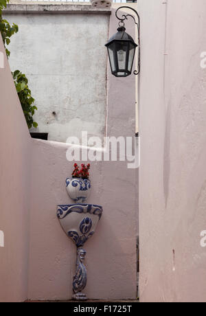 Porcelain planter & fountain on wall in passageway off  Calle de Santa Rita in the old town of Colonia del Sacramento, - Stock Photo