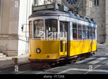 Trolley car descends Largo da Se in front of Catedral da Se in the Alfama district of Lisbon Portugal - Stock Photo