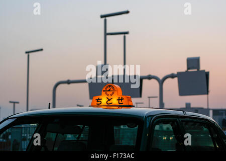 Taxi cab roof with light on early morning, airport in Japan. - Stock Photo