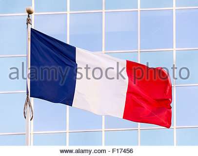 National flag of France. It is a tricolour flag featuring three vertical bands of royal blue, white, and red with - Stock Photo