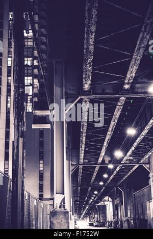 Urban Night. Chicago Alley with Train Bridge. Violet Color Grading. Chicago, United States. - Stock Photo