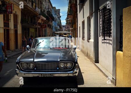 Black vintage classic American car parked in a Havana street in Cuba - Stock Photo