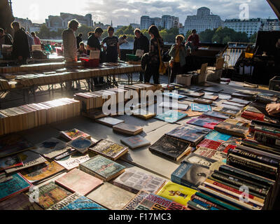 Books for sale on the south bank of the river thames in central london in late summer sunshine - Stock Photo